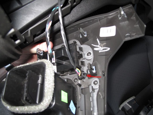 Disconnect the wiring harness for the headlight switch and DIC buttons.